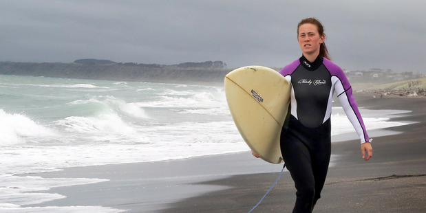 QUICK RESPONSE: Whanganui surfer Melina von Kwiatkowski assisted swimmers caught in a rip at Castlecliff's North Mole on Monday. PHOTO/STUART MUNRO