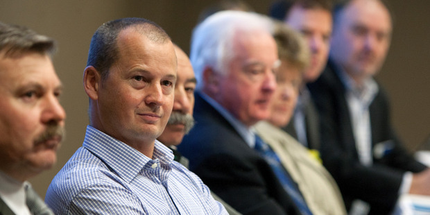 CEO Alastair Rhodes, left, at the BayTrust annual public meeting in Rotorua in August last year.  Photo/File
