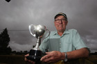 Glenanthony Stud studmaster Tony Thompson with the Dannevirke A and P Show's Meat and Wool Trophy last year.