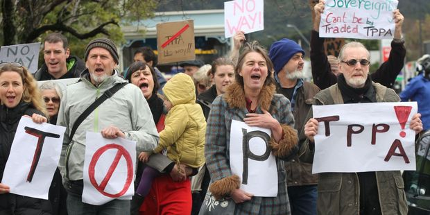 Wairarapa protesters against the TPPA march down Featherston's main street in Wellington. Photo / Andrew Bonallack