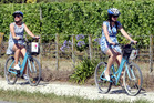 WHEELING IN: For Leigh Youngman (left) and Shirley Richardson, the day was perfect for two-wheel travel between the participating wineries. PHOTO/ Paul Taylor