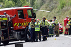 CRASH: Emergency services at the scene of the crash on the Napier-Taupo Road earlier today. PHOTO/PAUL TAYLOR