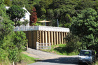 Tensions are high in Rawhiti over this retaining wall, built by an Auckland evangelist in breach of a resource consent. PHOTO / PETER DE GRAAF
