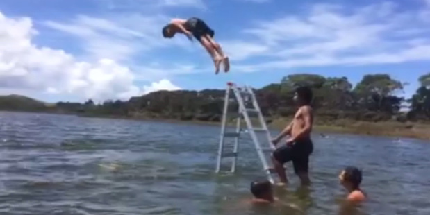 Loading A 30-second clip of Kaitaia kids jumping off a ladder in Lake Ngatu has gone global with more than 300,000 views in its first 48 hours online.