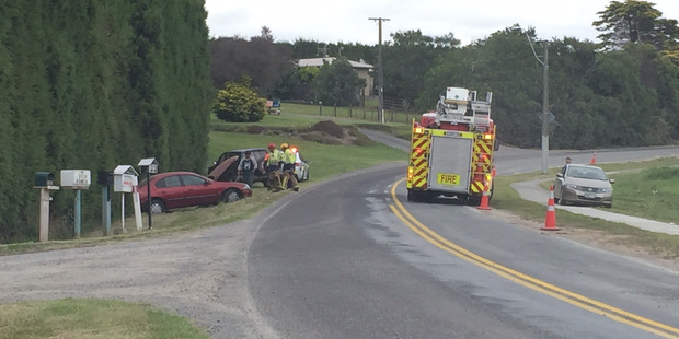 Emergency services at the scene of car crash in Matapihi Rd this evening. Photo/George Novak