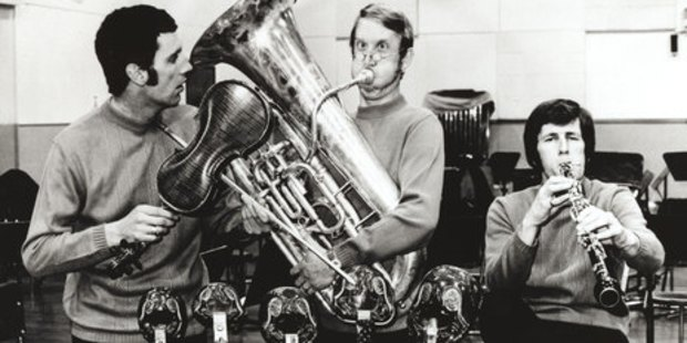At the height of their fame there was always time for a spot of fun - Alec (centre) took on the brass while Dave Luther (left) and John Reilly tuned up their way.