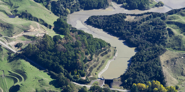 A temporary structure is being constructed at the joining of the Waihi stream and Waiau river to stop the silt flow. Photo / Peter Scott