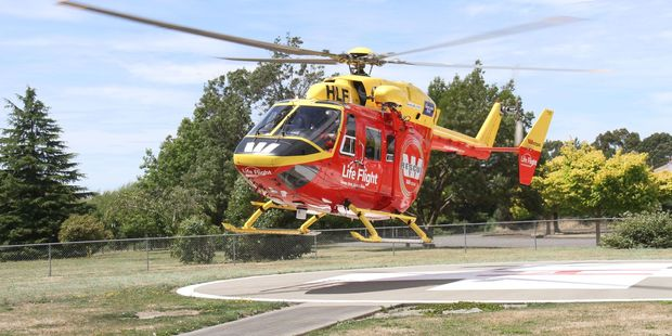 The Life Flight Westpac rescue helicopter touches down at Wairarapa Hospital's helipad after collecting a near drowning for a father and daughter at Castlepoint. PHOTO/ANDREW BONALLACK
