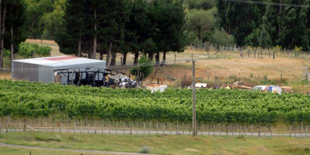The heat-buckled remnants of a large storage shed that was razed in a midnight fire at Murdoch James Estate Winery near Martinborough overnight Wednesday. PHOTO/NATHAN CROMBIE