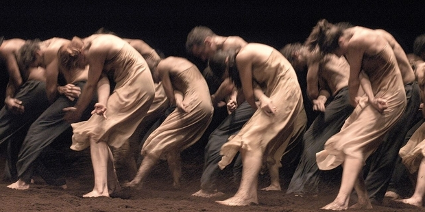 Dancers in Bausch's The Rite of Spring, performed on an earth floor.