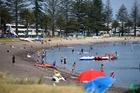 Beachgoers at Pilot Bay yesterday. Photo / George Novak