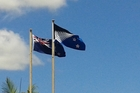 The New Zealand flag (left) and its proposed replacement that will be voted on in a referendum in March, are flying at a number of sites across Northland, including  Forum North, Whangarei. Photo / Mike Dinsdale