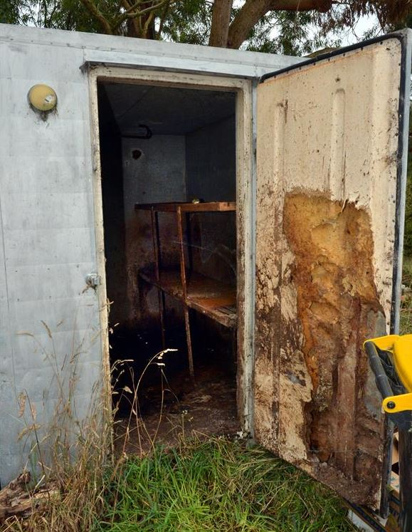 Dog kept in this coolstore allegedly clawed its way through the fibreglass wall lining, polystyrene insulation barrier and finally the metal outer skin. Photo:  Stephen Jaquiery and Gerard O'Brien/Otago Daily Times