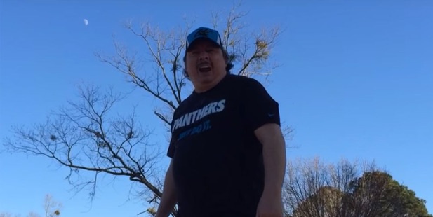 Panthers superfan Ked Woodley sings his fight song Dominate The Foe. photo / YouTube