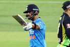 Virat Kohli celebrates reaching 50. Photo / Getty