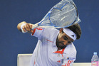 Marcos Baghdatis smashed four racquets during a tantrum. Photo / getty