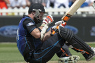 New Zealand's Mitchell McClenaghan falls to the ground after being hit in the eye. Photo / Mark Mitchell