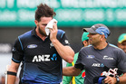 Mitchell McClenaghan leaves the field after being hit. Photo / getty