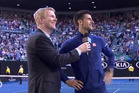 Novak Djokovic talks to a heckler at the Australian Open. Photo / YouTube