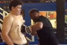 Emiliano Rivera absorbs Mark Hunt's powerful body shot. Photo / YouTube