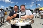 Oyster tasting at Auckland Seafood Festival. Pictured are Martin Bosley and Brett McGregor. 30th January 2016 New Zealand Herald photograph by Doug Sherring