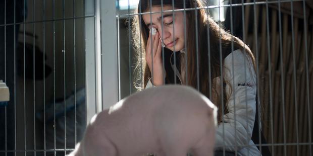 Catherine Smith, 12, tears up as she says goodbye to Wee Wee. Washington Post photo by Linda Davidson