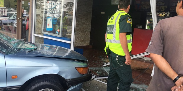 The elderly woman accidentally accelerated her car through the storefront. Photo / Supplied by Satwinder Singh