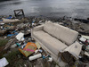 A file image from 2015 shows a discarded sofa on the shore of Guanabara Bay in Rio de Janeiro. Photo / AP