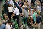 Medics and spectators take Nigel Sears to hospital. Photo / Getty