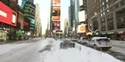 Snow cleanup underway in Times Square