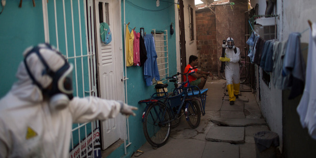Municipal workers sprays insecticide to combat the Aedes aegypti mosquitoes. Photo / AP