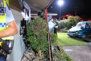 The driver of a ute died after it smashed into a parked car then into a house in Otumoetai Rd yesterday. Photo / John Borren