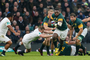 Trendai Mtawarira of South Africa slips the attempted tackle of Dylan Hartley of England. Photo / AP
