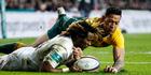 Marlon Yarde of England beats Israel Folau of Australia to the ball to score a try. Photo / AP
