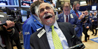 Trader Peter Tuchman works on the floor of the New York Stock Exchange. Photo / AP