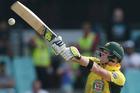 Australia's Steve Smith plays at a high ball against New Zealand. Photo / AP