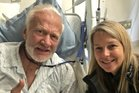 Buzz Aldrin gives the thumbs up from his hospital bed with surprise visitor Dava Newman of NASA. Photo / Twitter.