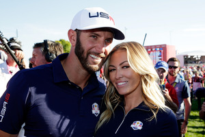 Dustin Johnson and his wife Paulina Gretzky celebrate after winning the Ryder Cup. Photo / Getty