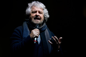 Beppe Grillo, former comedian and founder of the Movimento 5 Stelle (Five Star Movement), speaks during a demonstration to support the 'No' to the constitutional referendum. Photo / Getty