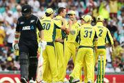 osh Hazlewood of Australia celebrates with team mates after taking the wicket of Tom Latham. Photo / Getty