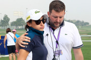 Anne-Lise Caudal of France is consoled by the Tournament Director Michael Wood after her caddie collapsed and died on the course. Photo / Getty
