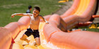 7 year old Daniel Pritchard takes on the giant water slide at the Silverdale Adventure Park. Picture / Dean Purcell