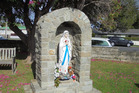 The statue of Mary sits in the grotto at St Joseph's Church in Helensville. Photo / via @Timespanner Facebook
