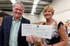 Port of Tauranga CEO Mark Cairns hands over a $6000 cheque toT Tauranga Community Foodbank chairwoman Sharon Hitchcock. Photo/ George Novak/061216gn01bop.JPG
