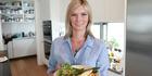 Chelsea Winter cooking fish. Photo / Doug Sherring