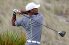 Tiger Woods watches his shot from he third tee during the third round at the Hero World Challenge golf tournament. Photo / AP