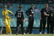 Australia's Steven Smith, left, waits for a new batting partner after Mitchell Marsh was run out during their one day international cricket match against New Zealand. Photo / AP.