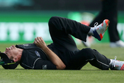 New Zealand's Tim Southee grimaces upon injuring himself after coming onto the field as a substitute fielder against Australia. Photo / AP.