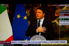 Italian Premier Matteo Renzi is seen on a TV monitor speaking during a press conference at the premier's office Chigi Palace.