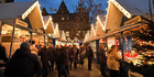 People visit a traditional Christmas market in the center of Muenster, Germany. Photo / AP